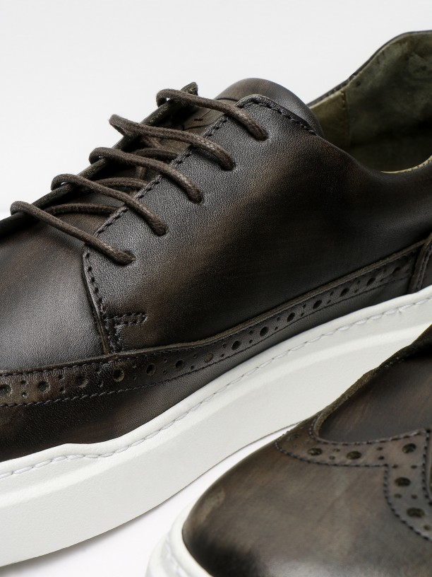 Leather sneakers with pricked detail