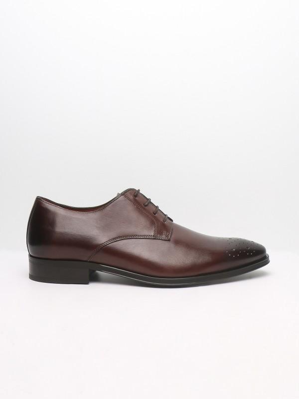 Sapato elegante de pele