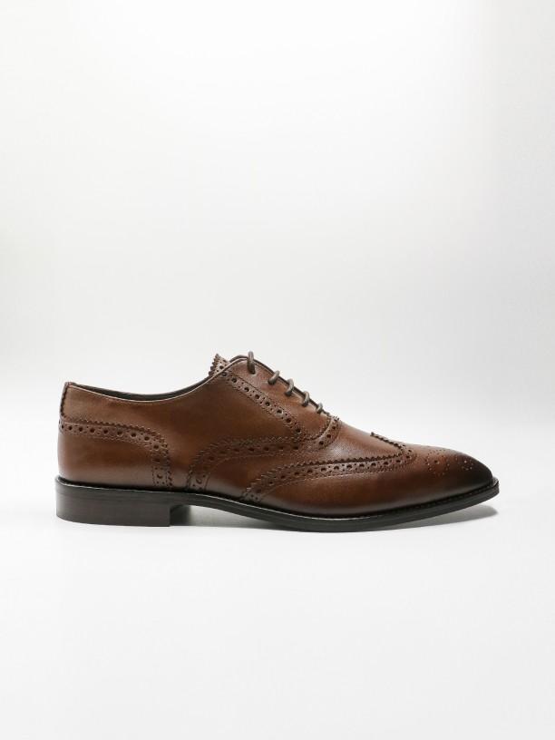 Zapato de vestir piel picado